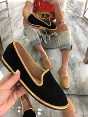 Black exclusive loafers with gold frills